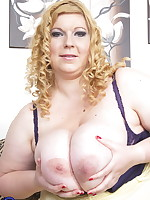 Naughty BBW showing off her huge breasts and then some